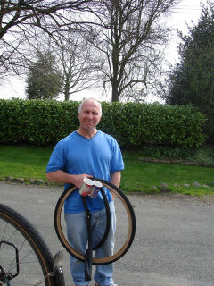 Keith with teacups, damaged inner tube and tyre